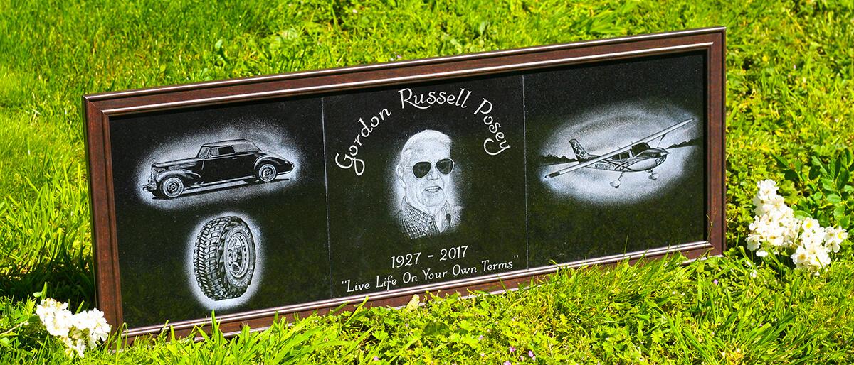 Framed hand etched portrait on black granite plaques